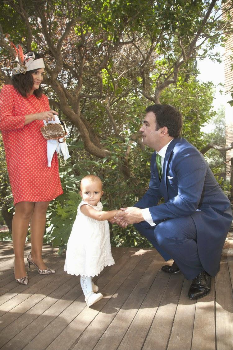 Natalia, invitada con lunares de Dolores Promesas